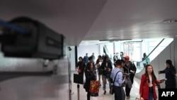 A thermal scanner monitors arriving passengers at Phnom Penh international airport in Cambodia, Jan. 22, 2020.