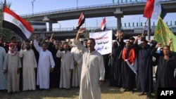 Irački demonstranti učestvuju u antivladinim protestima u gradu Nadžafu, 25. oktobra 2019.