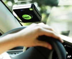 The Tiwi in-vehicle monitoring device mentors teens with verbal alerts to help them develop better driving habits.