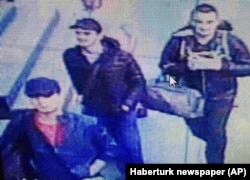 FILE - In this photo made from a video, people believed to be the attackers walk in Istanbul's Ataturk airport, June 28, 2016.