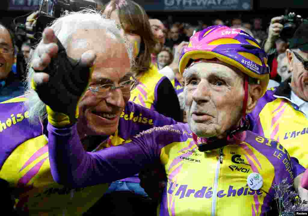 French cyclist Robert Marchand, 105 years old, reacts after he rode 22,528 kilometers (14,08 miles) in one hour to set a new record at the indoor Velodrome National in Montigny-les-Bretonneux, southwest of Paris, France.