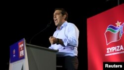 FILE - Former Greek Prime Minister and leader of leftist Syriza party Alexis Tsipras delivers a speech during a pre-election rally in the western suburb of Egaleo, in Athens, Sept. 3, 2015.