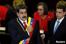 Venezuela's President Nicolas Maduro gestures during a ceremony to mark the opening of the judicial year at the Supreme Court of Justice (TSJ), in Caracas, Venezuela, Jan. 24, 2019.