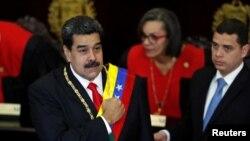 ប្រធានាធិបតីប្រទេសវ៉េណេស៊ុយអេឡាលោក Nicolas Maduro ស្ថិតក្នុងពិធីបើករបស់តុលការកំពូល Supreme Court of Justice (TSJ) ទីក្រុង Caracas ប្រទេសវ៉េណេស៊ុយអេឡាកាលពីថ្ងៃទី២៤ ខែមករា ឆ្នាំ២០១៩។