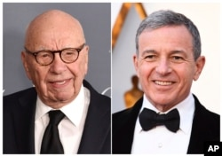 FILE - This combination photo shows Fox News chairman and CEO Rupert Murdoch at the WSJ Magazine 2017 Innovator Awards in New York, Nov. 1, 2017, left, and Disney CEO Bob Iger at the Oscars in Los Angeles, March 4, 2018.
