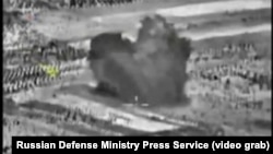 An image taken from footage made available on the Russian Defense Ministry's official website purports to show an explosion after airstrikes carried out by the Russian air force, Oct. 3, 2015.