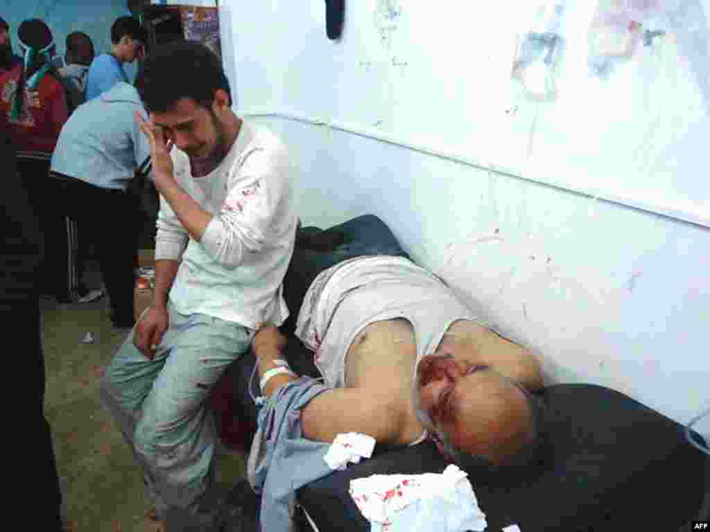 Wounded men in the Sunni district of Bab Amro in Homs, February 8. (Reuters)