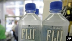 Bottles of Fiji water rest on a shelf at Corky's 12th Street Market, in Cleveland. The US-owned company has agreed to a massive tax hike imposed by the military government of Fiji (FILE).