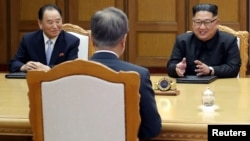 Kim Yong Chol, left, sits next to North Korean leader Kim Jong Un during talks with South Korean President Moon Jae-in during their summit at the truce village of Panmunjom, North Korea, May 26, 2018.
