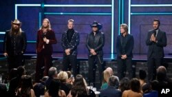 (l to r) Chris Stapelton, Brian Kelly, Tyler Hubbard, Jason Aldean, Keith Urban and Luke Bryan are seen at 2017 CMT Artist of the Year Awards at Nashville's Schermerhorn Symphony Center on Wednesday, Oct. 18, 2017, in Nashville, Tenn.