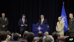 From left: U.S. General John Allen, nominated as Supreme Allied Commander Europe, NATO Secretary General Anders Fogh Rasmussen, United States Secretary of Defense Leon Panetta, current Supreme Allied Commander Europe U.S. Admiral James Stavridis, and U.S.
