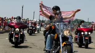 FILE - Participants in the Rolling Thunder annual motorcycle rally ride past Arlington memorial bridge during the parade ahead of Memorial Day in Washington, Sunday, May 24, 2015.  (AP Photo/Jose Luis Magana)