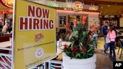 FILE - A restaurant posts a sign hoping to draw in job applicants, in Miami, Florida, Feb. 9, 2016. The Labor Department reported Friday that the U.S. economy had a net gain of 235,000 jobs for the month of February.