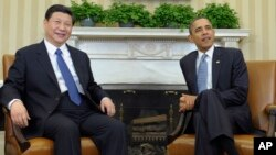 President Barack Obama with Chinese President Xi Jinping (File photo).
