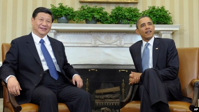 President Barack Obama meets with Chinese Vice President Xi Jinping, Feb., 14, 2012, in the Oval Office of the White House in Washington.