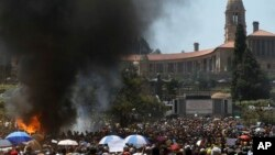 Students burn portable toilets during their protest against university tuition hikes outside the union building in Pretoria, South Africa, October 23, 2015.