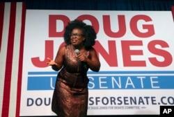 Actress Uzo Aduba speaks during a rally for Democratic candidate for U.S. Senate Doug Jones, Monday, Dec. 11, 2017, in Birmingham, Alabama. Jones defeated Republican Roy Moore.