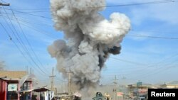 FILE - Smoke rises after suicide car bomb attack in Kunduz province, February 10, 2015.
