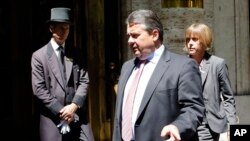 FILE - Germany's Economy and Energy Minister Sigmar Gabriel (C).
