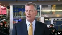 FILE - In this photo provided by WNYW Fox 5 NY, New York Mayor Bill de Blasio speaks during a news conference in New York's Times Square, Nov. 18, 2015.