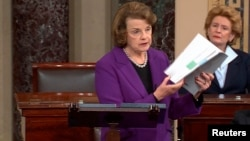 Senate Intelligence Committee Chairwoman Dianne Feinstein (D-CA) (L) discusses a newly released Intelligence Committee report on the CIA's anti-terrorism tactics, in a speech on the floor of the U.S. Senate, in this still image taken from video, on Capito