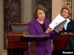 Senate Intelligence Committee Chairwoman Dianne Feinstein (D-CA) (L) discusses a newly released Intelligence Committee report on the CIA's anti-terrorism tactics, in a speech on the floor of the U.S. Senate, Capitol Hill, De. 9, 2014.