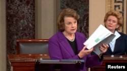 Senate Intelligence Committee Chairwoman Dianne Feinstein (D-CA) (L) discusses the newly released Intelligence Committee report on the CIA's anti-terrorism tactics, in a speech on the floor of the U.S. Senate, Dec. 9, 2014.