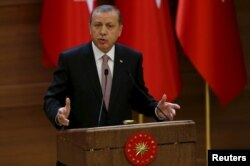 FILE - Turkish President Recep Tayyip Erdogan makes a speech during his meeting with mukhtars at the Presidential Palace in Ankara, Turkey, Nov. 26, 2015.