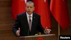 FILE - Turkish President Recep Tayyip Erdogan delivers a speech at the Presidential Palace in Ankara, Turkey, Nov. 26, 2015.