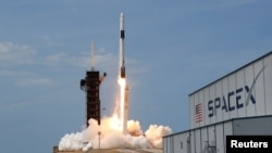 A SpaceX Falcon 9 rocket and Crew Dragon spacecraft carrying NASA astronauts Douglas Hurley and Robert Behnken lifts off during NASA's SpaceX Demo-2 mission to the International Space Station from NASA's Kennedy Space Center in Cape Canaveral, Florida, U.S., May 30, 2020. REUTERS