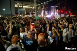 Demonstrators gather near the Staples Center during a march through the streets of downtown Los Angeles in protest following the election of Republican Donald Trump as president of the United States, Nov. 10, 2016.