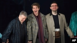 "(L-R) Nathan Lane, Andrew Garfield and James McArdle participate in the curtain call for the ""Angels in America"" Broadway revival opening night at the Neil Simon Theatre, March 25, 2018, in New York."