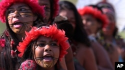 Brazilian Pataxo women take part in a ritual dance during a protest against a proposed constitutional amendment that would put demarcation of indigenous lands into the hands of the Congress, in front of Brazil's National Congress, in Brasilia, Nov. 10, 2015.