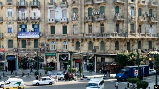 The balcony of the Cairo Inn in central Cairo overlooks busy Talat Harb Square, only a short walk from iconic Tahrir Square, December 14, 2011.