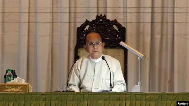 Myanmar's President Thein Sein talks during a meeting with representatives from civil societies at the Yangon Region Parliament Building in Rangoon, January 20, 2013.