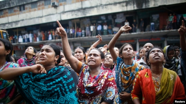 Garment workers shout as they call on other workers to join them during a protest in Dhaka, Sept. 23, 2013.