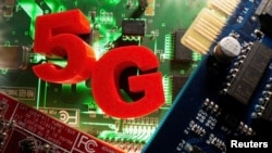 FILE PHOTO: 3d printed objects representing 5G are put on a motherboard in this picture illustration taken April 24, 2020. (REUTERS/Dado Ruvic /Illustration)