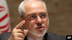 FILE - Iranian Foreign Minister Mohammad Javad Zarif speaks to the media after closed-door nuclear talks on Iran in Vienna, Austria.