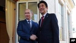 Владимир Путин и Синдзо Абэ. Сочи, 8 февраля 2014г.