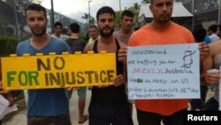Asylum seekers protest on Manus Island, Papua New Guinea, in this picture taken from social media, Nov. 3, 2017
