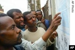 Ethiopian voters check 2005 provisional results at a polling station in Addis Ababa 16 May 2005