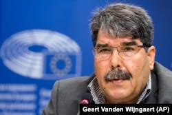 FILE - Salih Muslim addresses the media on the situation in Syria, the war against Islamic State and the urgent humanitarian needs of the civilian population, at the European Parliament.