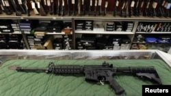 FILE - An AR-15 style rifle is displayed at the Firing-Line indoor range and gun shop, in Aurora, Colorado. A school district in the western U.S. state of Colorado is set to arm its security personnel with semi-automatic rifles similar to those used by United States military.