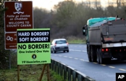 FILE - A poster against a hard border stands on the border between Northern Ireland and the Republic of Ireland near the town of Derrylin, Northern Ireland, Dec. 12, 2018.