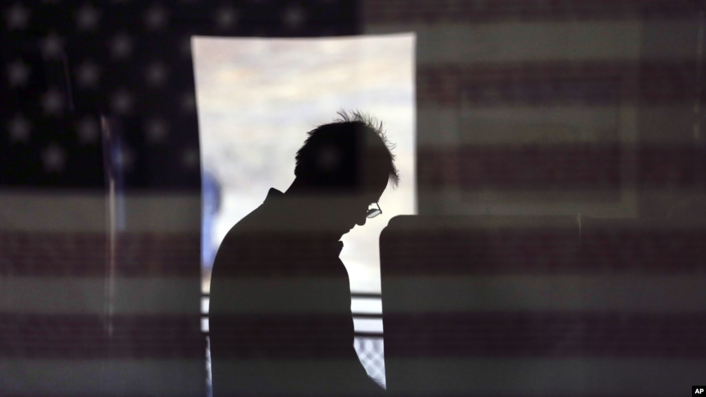 File A Voter Is Reflected In An Image Of A U S Flag As He