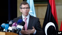 "FILE - U.N. Special Representative for Libya Bernardino Leon tells reporters in Skhirat, Morocco, on Sept. 13, 2015, that rival governments have reached a ""consensus"" on the main elements of a political agreement."