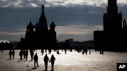 FILE - People walk through Red Square in Moscow.