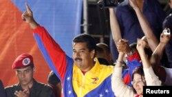Venesuela muvaqqat rahbari Nikolas Maduro prezident saylovlarida g'olib bo'ldi, Karakas, 14-aprel, 2013-yil.