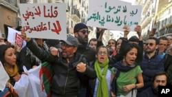Demonstrators rally to denounce President Abdelaziz Bouteflika's bid for a fifth term, in Algiers, Algeria, Feb. 24, 2019.