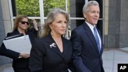 Former Virginia Gov. Bob McDonnell, right, and his wife Maureen, center, leave Federal court after a motions hearing in Richmond, Va., May 19, 2014.